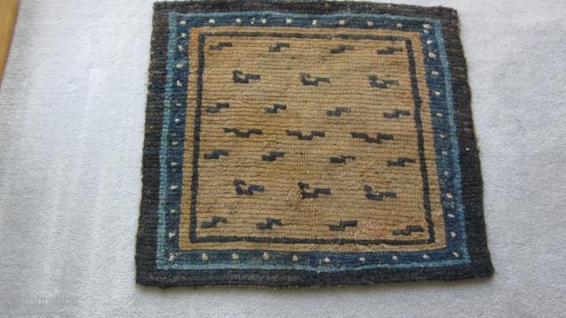 Tibetan mat with primitive tiger stripes. Before 1900. Some repairs. POR