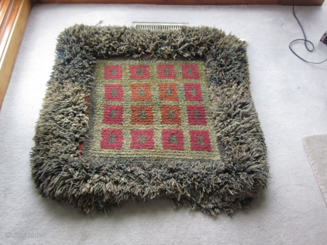 Tibetan: Temple Wangden meditation mat, about 3 by 3 ft. c. 1900,or earlier. Excellent condition. Ask for more shots showing the outer red band around the central squares, now obscured by the  ...