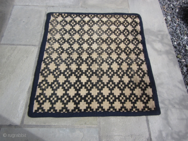 "Tibetan mat, with overall geometric design, possibly cut down from larger rug, 2'8"" by 3' c.1900 Signs of wear. Not expensive."