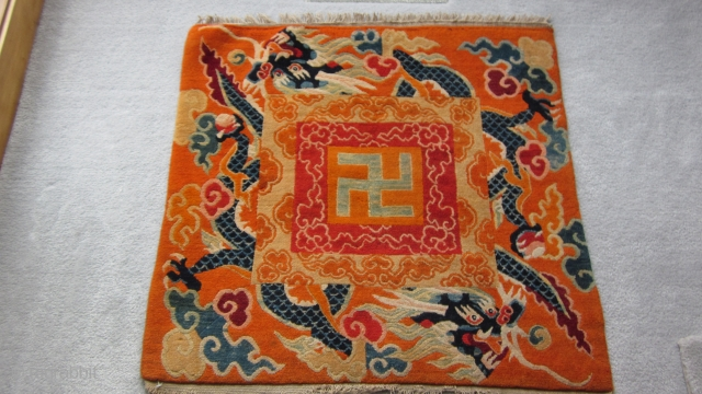 Tibetan mat, organized to copy Chinese silk design. Gelupga order colors. Expert two row repair at top, some fraying of lower selvedge. C.1920-30