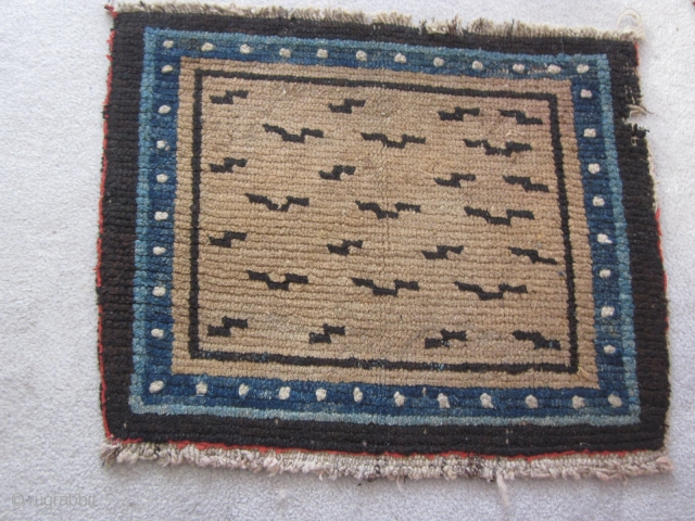 Tibetan, mat with tiger stipes,20 by 25 inches, 1900 or earlier. Small nibble in upper right border. From private collection of 30 years standing  SOLD