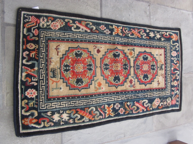 Tibetan Khaden, three guls and Chinese symbols in border, post-1900, 29 by 54 inches,excellent condition