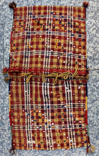 An unusual saddlebag woven with the moj or jajim technique by a Qashqai weaver. Very finelly spun wool and cotton. Natural dyes and in excellent condition. 106x56 cms