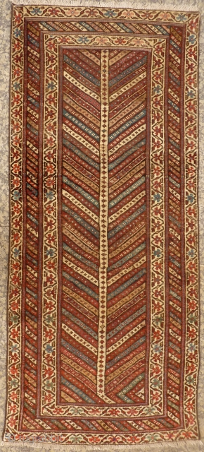Lovely Kazak Gendje runner with earthy colours, and a lot of undyed wool. Low to medium overall pile, some repiling. With the arrival of the spring the branches started blooming! 198x88 cms,  ...