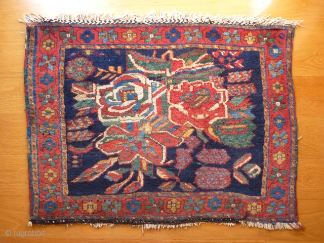 Afshar piled bag-face or mat, 59x79cms, 19th century, good condition with vibrant saturated natural colours, abstracted flower motifs with contemporary looking geometric details, cotton warps, good overall pile, no repairs, holes or  ...