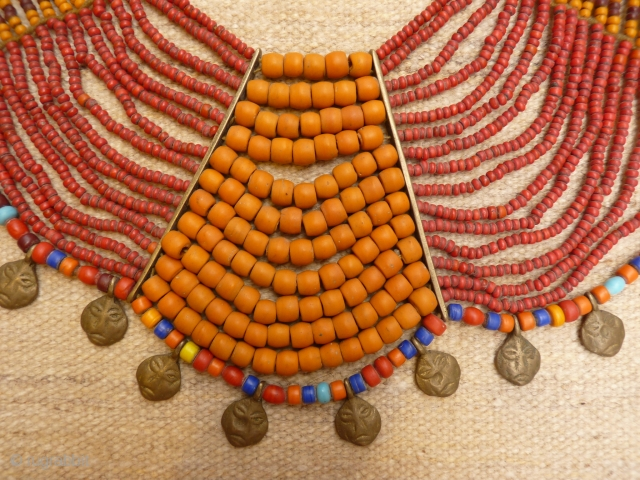Antique Nagaland necklace with 16 glass strands, 20 brass heads and a shell for clossing. Complete and all original (including the dirt). 650 grams, about 1 metre.