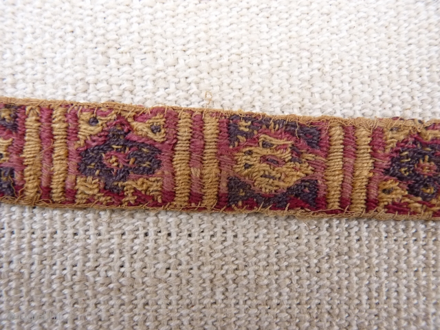 A Huari Culture band, 8th to 12th century, Huari Culture , South Central Perú. Wool. From a Spanish private collection. 39x2,8 cms. (T1511011)