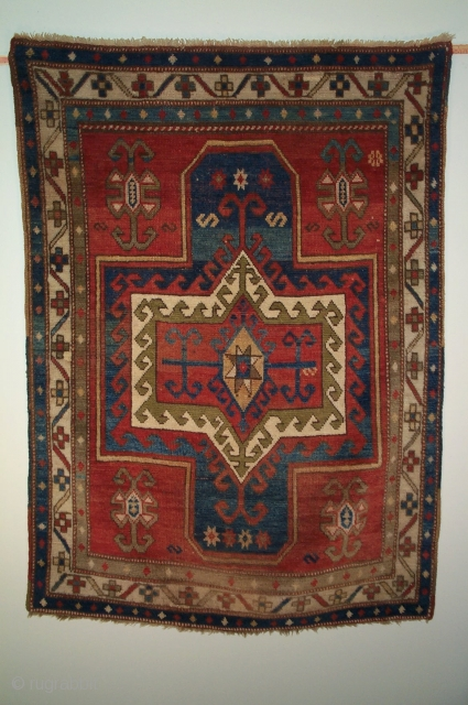 Caucasian Fachralo prayer rug, late 19th century, 4.6 x 3.3.  Good example of meander-and-cross border.  Silky wool, floppy handle.  Looks like a synthetic dye completely washed out, front and  ...