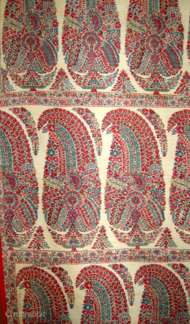 Kashmir shawl fragment panel. Circa 1820. 100 x 84 cm. Made up of four sections of an early and excellent shawl.Backed onto fabric and ready to display.