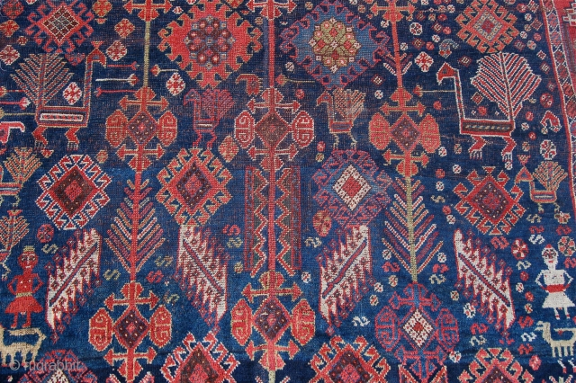 Lovely antique south west persian carpet. Shekralu design but probably khamseh. 19th century, About 11 x 7 feet. Some wear and a sewn split one end. Unusual to see such a large south  ...
