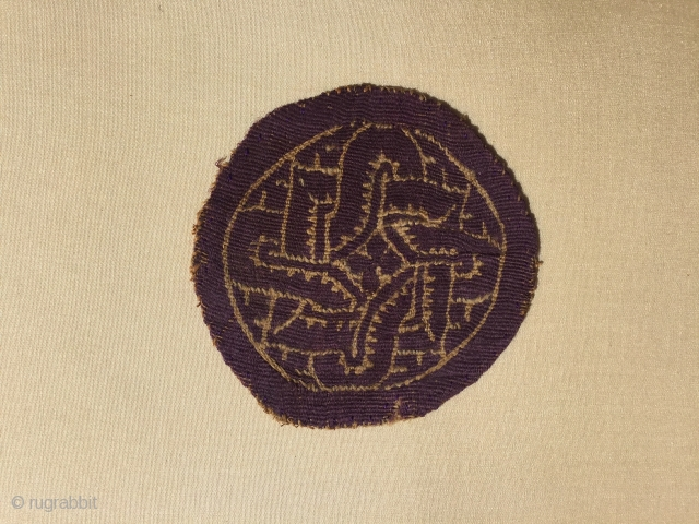 Coptic textile. Egypt, Circa 6-800 A.D. 8x8cm. Attached onto board. Endless knot design in good condition.