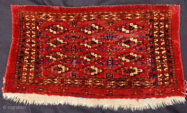 Good quality Tekke kap. 57 x 30cm. Early to mid 19th century. Silk highlights on a juicy red ground.