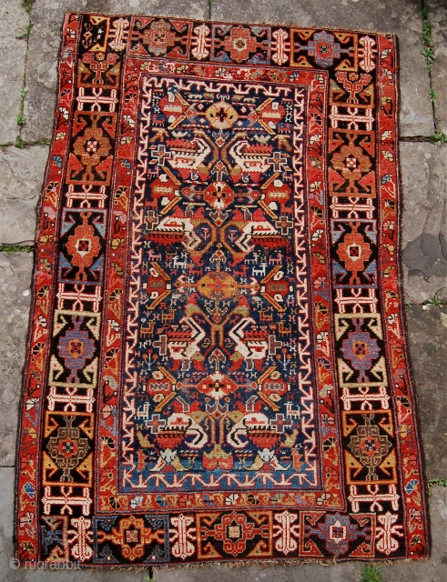 Lovely and quite early kurdish rug. Super saturated colours with a field design reminiscent of kurdish bag faces and a bold kufic border. Some edge losses and repairs. Mid 19th century. 172  ...