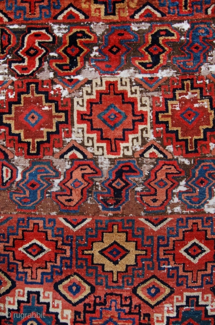 Unusual north west persian runner. Probably shashavan, possibly third quarter of the 19th century. Beautiful colours and lovely wool. Some wear and moth damage. 287 x 74cm.