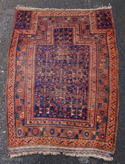 Unusual Baluch prayer rug. 19th century. 146 x 108 cm. Needs a clean and low pile down the centre.