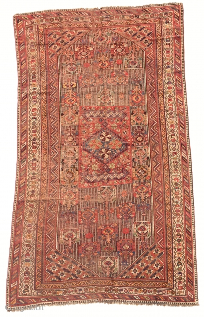 19th  Century khamseh rug. Too much worn but still charming. It's size is  295 x 170 cm