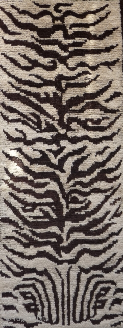 rare and nice drawn tiger skin design rug. the white and brown is undyed wool. this is not a tibetan weaving but it was made for a tibetan monastery. condition is good  ...