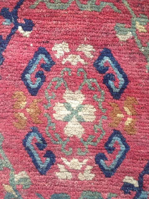 fragment of a mid 19th century tibetan monastic bench cover with a beautiful and rare design. very nicely aged natural colors. good condition.