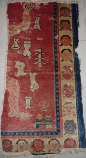 fragment of a very rare tantric rug depicting the tibetan sky burial. baotou/zuoqi area for the tibetan market.