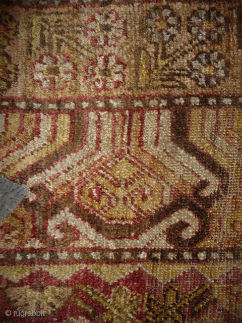 an early khotan fragment  in the khaden size (160cm), an interesting colors palette with an uncommon extensiv use of different golden yellow hue. fantastic wool and handle, cotton weft  mixed  ...