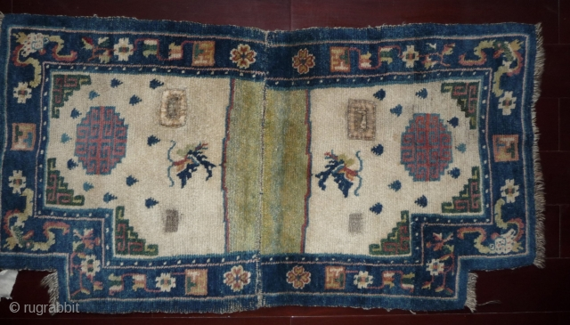 white ground tibetan saddle rug, good condition and colors, late 19th c.