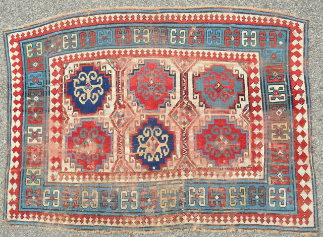 Mid 19th. C. Kazak rug (cut and shut). About 4 x 6 ft. Wear and uneven pile. Some cool features.