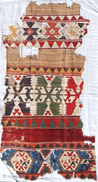 Early 19th c. Central Anatolian kilim fragment. Great color & bold scale. Conserved and professionally mounted on linen.