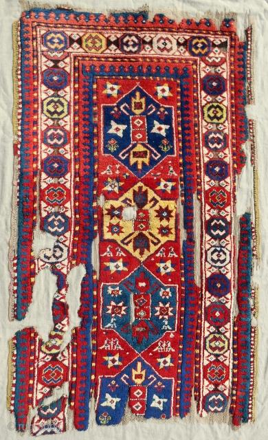 Full pile Caucasian Genje rug fragment. Circa 1870. Mounted professionally on linen. Stunning color!