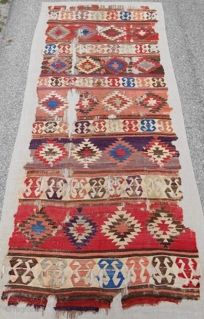 """Early Central Anatolian banded """"one-piece"""" kilim. Conserved and mounted on linen. 18th c. or older."""