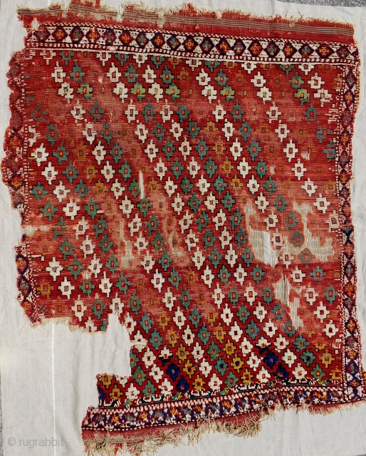 "Circa 1800 ""Cal"" Western Anatolian sleeping rug. Conserved and mounted on linen."