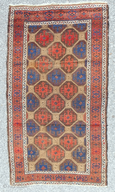 Uncommon Baluch rug with a distinctive Memling gul lattice. Splendid color with true camel. Good condition. c. 1870.