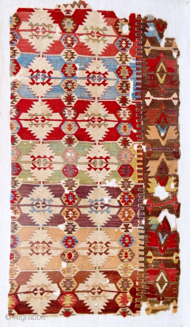 18th c. Central Anatolian kilim fragment. Fine weave. Remarkable color range. Conserved and mounted on linen.
