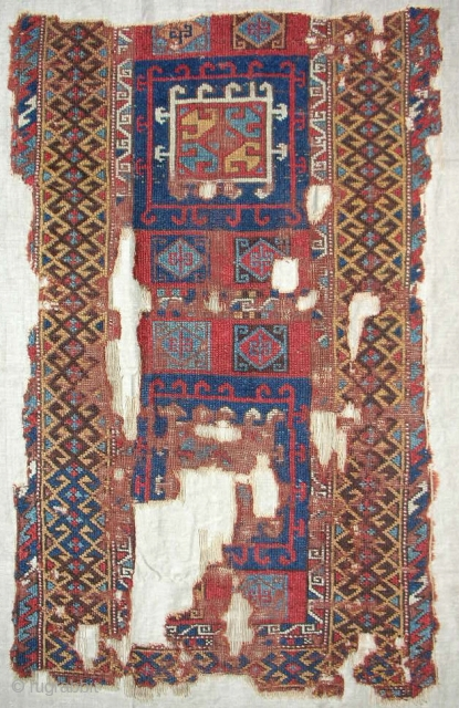 18th c. East Anatolian rug fragment. Very rare design. Conserved and professionally mounted on linen.