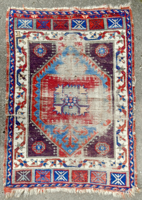 Rare central Anatolian yastik with exceptional color. Circa 1850 or older. Worn, but still has real gravitas.