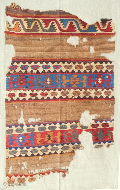 Circa 1800 Central Anatolian banded kilim fragment. Conservered and professionally mounted on linen. Clear, saturated colors and true camel wool.