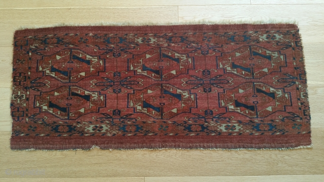 """Yomud bag face, very early and extremely fine weave. Loss of main border at ends. 41"""" x 18""""."""