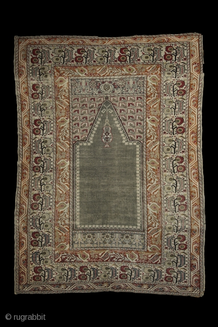 How to draw tension...  trembling borders with running flames and an empty green mihrab..... Ghiordes prayer rug, 172x125 cm, wool on cotton, ca 1900. More pieces: http://rugrabbit.com/profile/5160