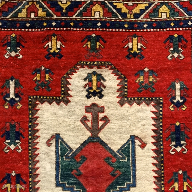 if you're looking for something really rare .... 'Frog-Kazak' prayer rug... i know only 7 published examples .... Please ask for more pictures and information! More beauties on sale: http://rugrabbit.com/profile/5160