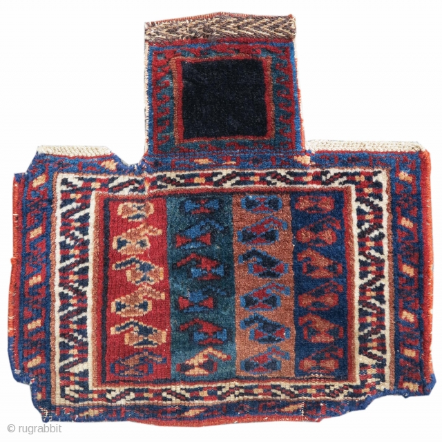 This small pile Afshar salt bag draws bands of paisleys against a ground of four different colored stripes. A white vine-scroll border frames the bottom portion of the piece, while a solitary  ...