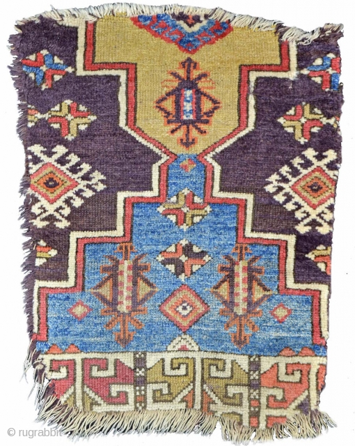 Central Anatolian Rug Fragment: The artful color palette of this Anatolian rug fragment combines speckled indigo sky-blue, pistachio, rose, and a highly successful aubergine, used both as pile and weft. Such a  ...