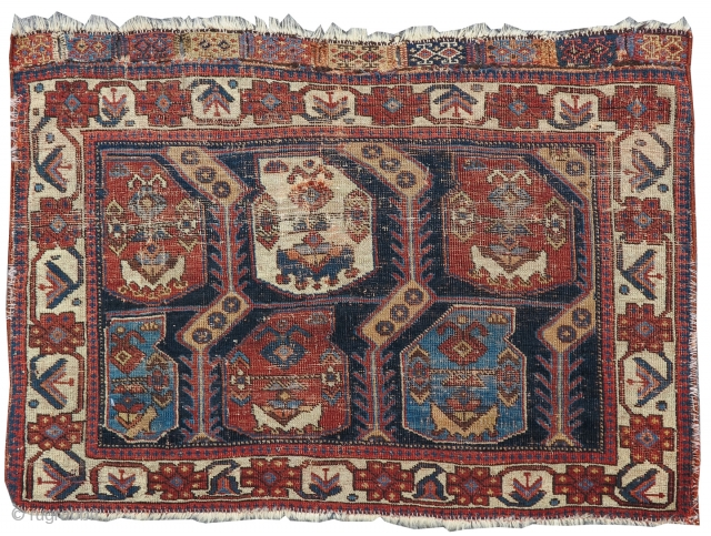 Finely woven with two rows of plump 'boteh' paisleys, this authentic Afshar bag face was one of a pair of fronts of a saddle bag set, or 'khorjin'. Tones of ochre compliment  ...
