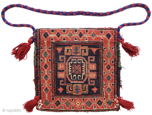 small Shahsevan sumak bag, probably a chanteh with added tassels and strap. size is 1'x1'. inv# 17691. Collection of Dr. and Mrs. William T. Price. 