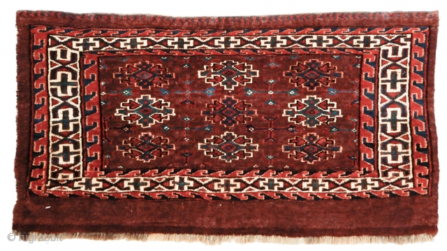 "Yomut Torba, 2'3"" x 1'3"". Colors are vivid and natural using a classic Yomud burgundy red field. Collection of Dr. and Mrs. William T. Price. Inv# 17727.