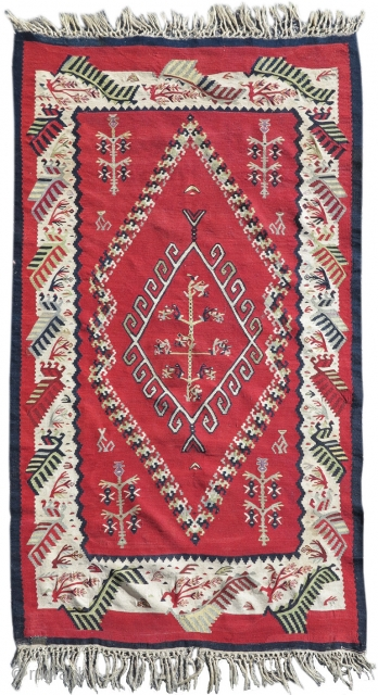 Sharkoy Kilim: Woven in the southeast Balkans, most probably Bulgaria or the Thracian region of European Turkey, this Sharkoy kilim combines a traditional Turkish latch hook central medallion with more refined curvilinear  ...