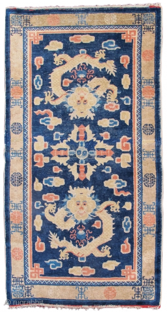"Ningxia / Ning Hsia rug with two dragons and a vajra in the field. ""Shu"" sign border. Late 19th century.