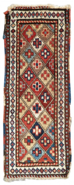 This exceptionally graphic long and narrow Shahsevan pile spindle weaving from Northwest Persia draws a colorful geometric field of diamonds within a white lattice. Such elongated pieces are often described as spindle  ...