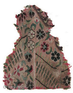 A rare early Chinese silk kesi tapestry fragment, woven with flowers and leaves, against an orange ground. Song Dynasty,  Circa 1200 AD 25 x 20 cm