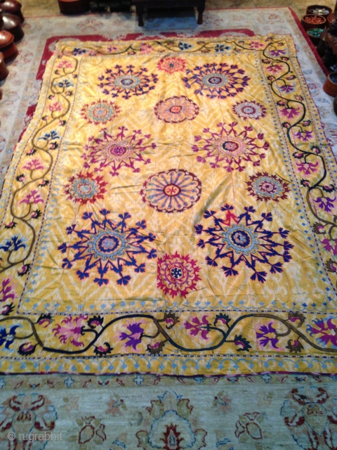 Nice old Ubzbek suzani, embroidery on yellow ikat very rare piece, some color run in some area and few small holes, size is arround 250/150.