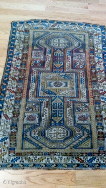 "Shirvan 19th cen.  62""x44""wool on wool, keyhole pattern, needs some work ...or not,..small hole and sewn area"