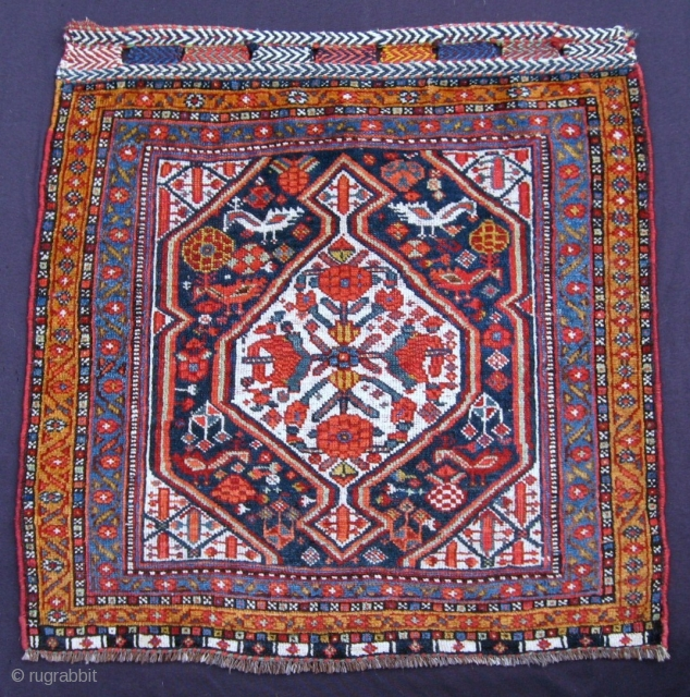 """Khamseh bird & pomegranate bagface, 27"""" x 27"""", Late 19th C. or early 20th C. A rare combination of both bird and pomegranate design elements. Saturated color and shiny wool."""